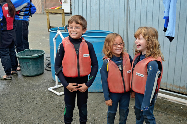 Cousins preparing for a kayaking trip