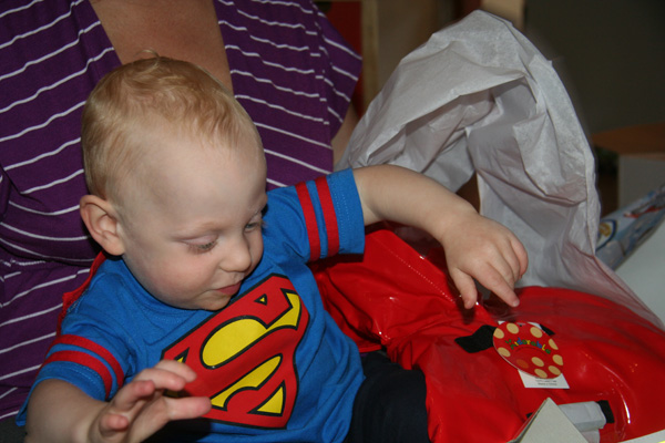 Sam the Anti-Preemie: Opening Judy\'s great gift (cute rain coat!)