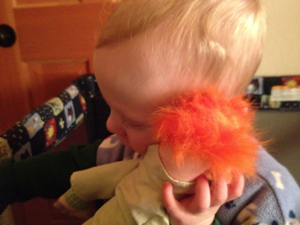 Sam and his favorite xmas gift: Beaker!