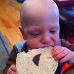 Sam the Anti-Preemie eats a bagel