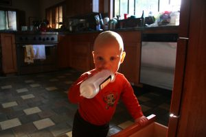 Sam the Anti-Preemie plays with a bottle