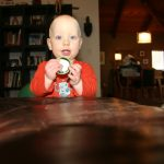 Sam the Anti-Preemie plays with a plate