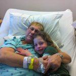 Tutu and Irene cuddling in the hospital
