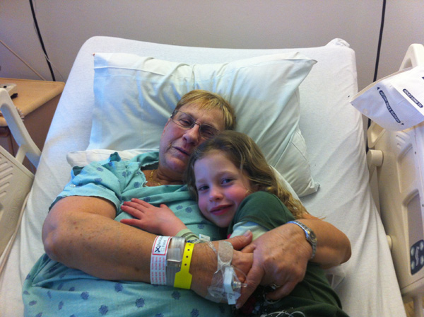Tutu and Irene cuddling in the hospital