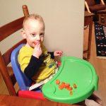 Sam the Anti-Preemie Eats a Persimmon