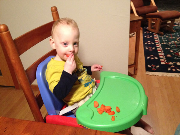 Sam the Anti-Preemie Eats a Persimmon