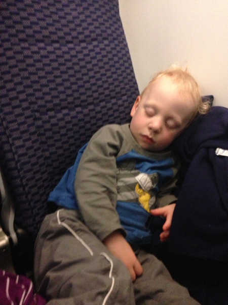 Sam the Anti-Preemie sleeping on the plane