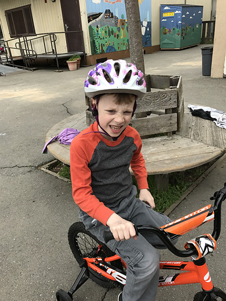 Sam the Anti-Preemie on his bike